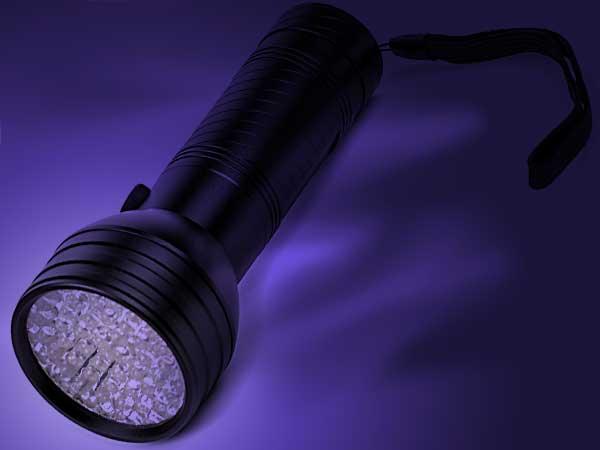 Photo illustration of UV black light flashlight.