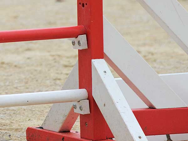 View of jump cups on dog agility bar jump.