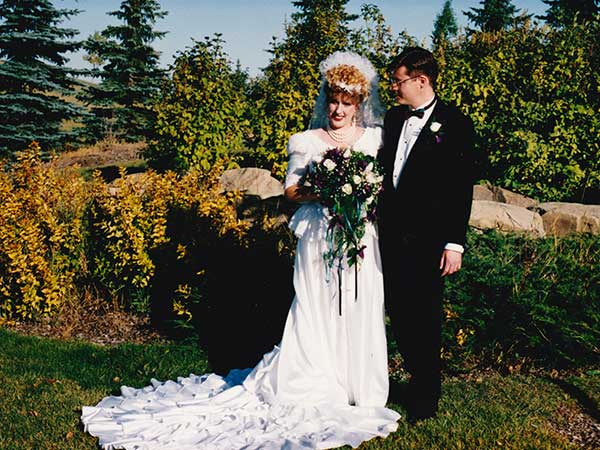 Beautiful young woman and handsome man on their wedding day.