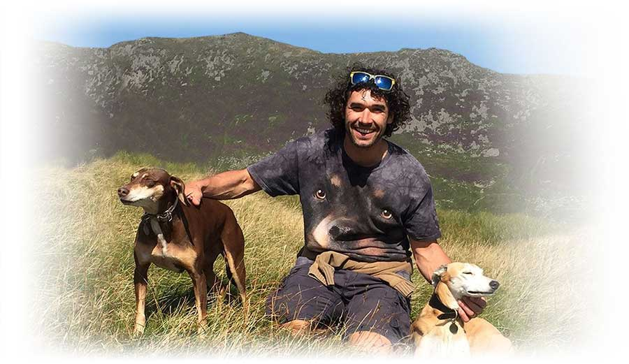 Professional dog trainer, Doggy Dan with two dogs